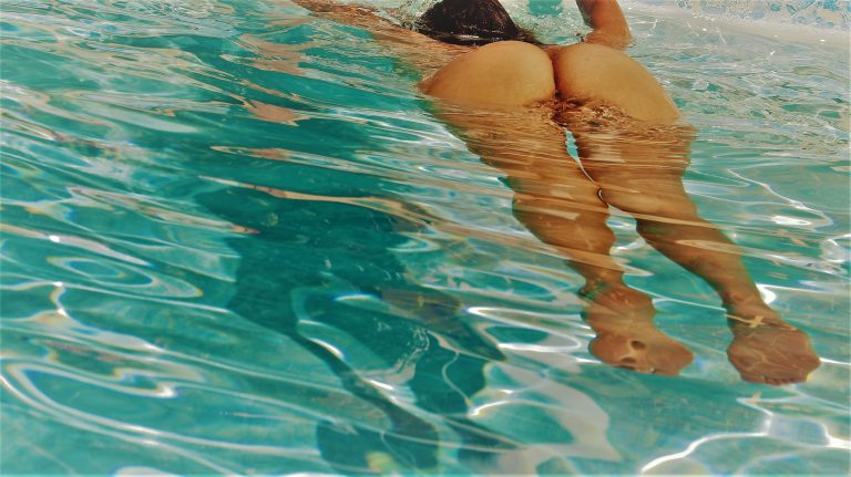 May more Elust 109 Header image swiming naked in a pool